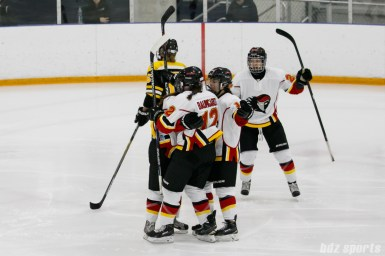 The Calgary Inferno celebrate Calgary Inferno forward Iya Gavrilova's (25) goal