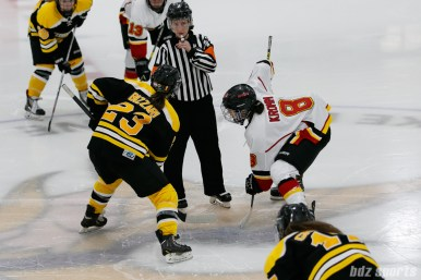 Boston Blades forward Melissa Bizzari (23) faces off against Calgary Inferno defender Erica Kromm (8)