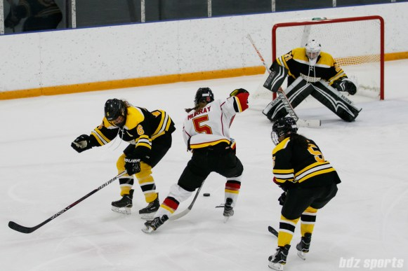 Calgary Inferno defender Kelly Murray (5) makes a move past Boston Blades forward Erin Kickham (6)