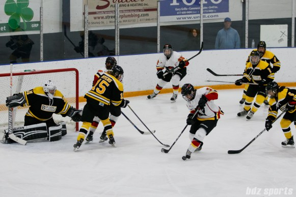 Calgary Inferno forward Brittany Esposito (7) controls the puck with her skate