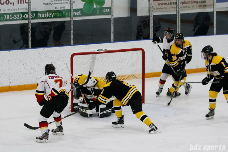 Boston Blades goalie Jetta Rackleff (21) comes up with the stop