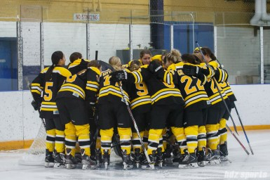 The Boston Blades huddle before the start of the game