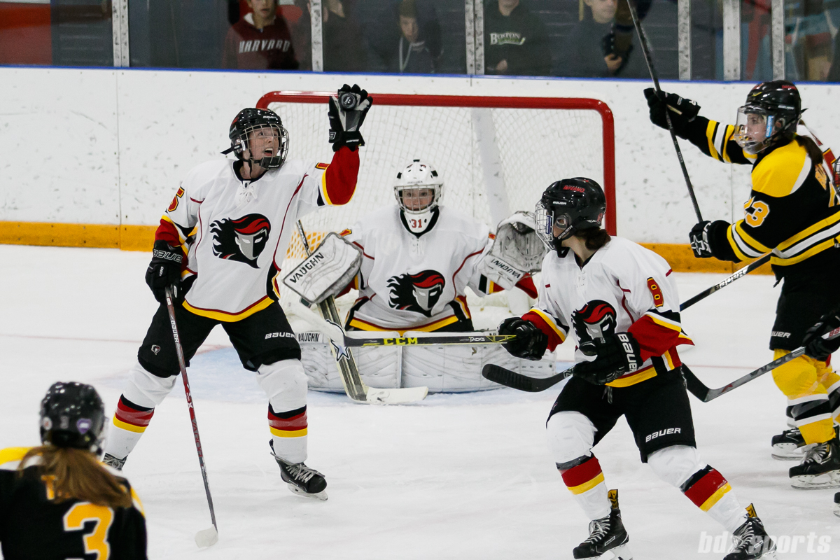 Calgary Inferno defender Kelly Murray (5) grabs the puck out of the air