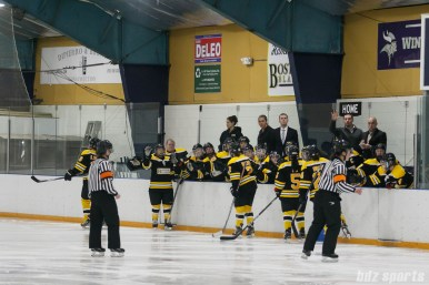 Boston Blades players high five after Boston Blades forward Meghan Grieves' (not pictured) goal in the third period