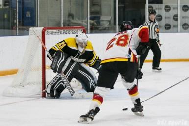 Calgary Inferno forward Louise Warren (28) takes on Boston Blades goalie Jetta Rackleff (21)