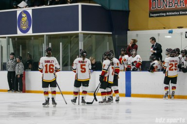 Calgary Inferno players Sophie Shirley (16), Kelly Murray (5), Brittany Esposito (7), and Megan Grenon (6) look on