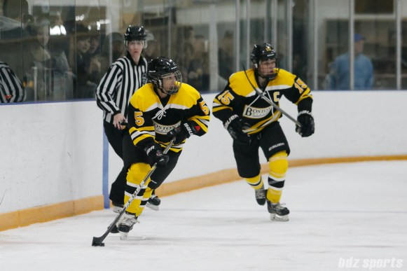Boston Blades forward Michelle Ng (5) brings the puck down the ice
