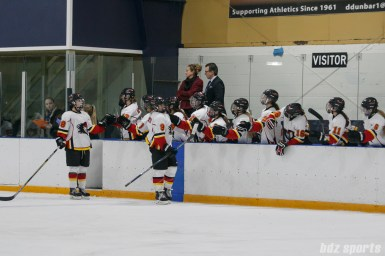 Calgary Inferno players Dakota Woodworth (9) and Erica Kromm (8) high five teammates after Woodworth's goal