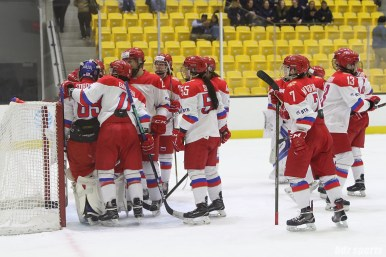 The Russian team congratulate goalie Mariia Sorokina (69) for her performance