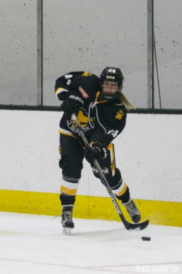 Boston Pride defender Paige Harrington (44) looks to clear out the puck