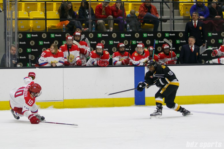 Boston Pride defender Kaliya Johnson (10) takes a shot on goal while Russian team defender Liudmila Belyakova (10) slides to block the shot