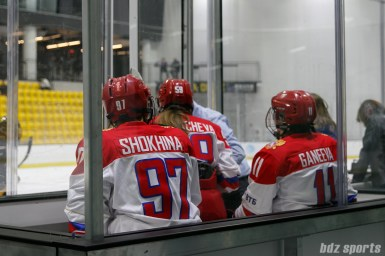 With 3 Russian team members receiving penalties for a melee, the Russian team's penalty box is crowded.
