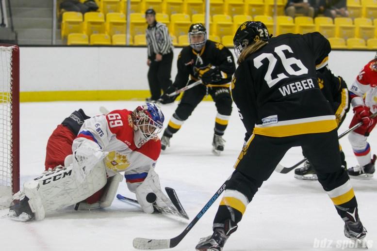Russian team goalie Mariia Sorokina (69)stops Boston Pride forward Janine Weber's (26) initial attempt on goal