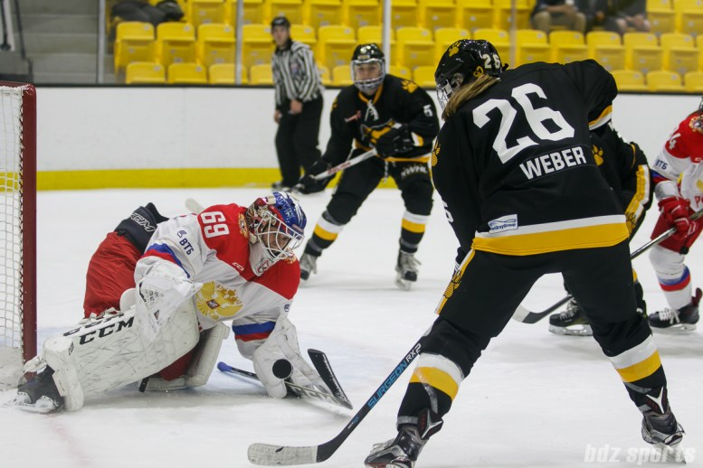 Russian team goalie Mariia Sorokina (69)stops Boston Pride forward Janine Weber's (26) initial attempt on goal