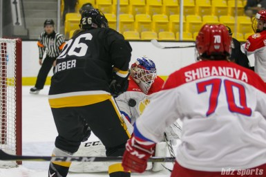 Russian team goalie Mariia Sorokina (69) makes a save in the final seconds of the game