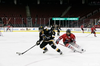 Boston Pride defender Meagan Mangene (57) controls the puck while Metropolitan Riveters forward Bray Ketchum (17) defends