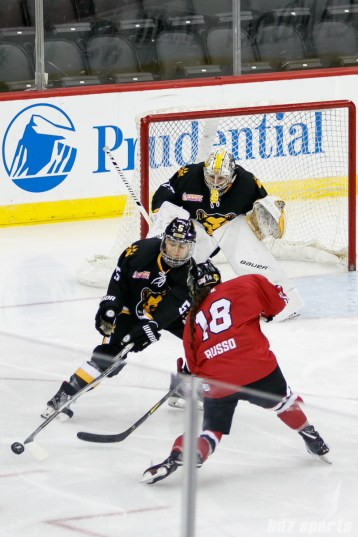 Boston Pride defender Alexandra Bender (5) sticks checks Metropolitan Riveters forward Rebecca Russo (18)