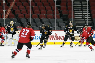 Boston Pride defender Kaliya Johnson (10) carries the puck out the Pride end