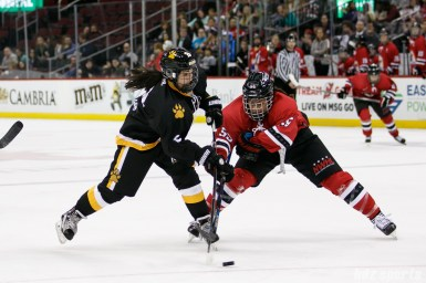 Boston Pride forward Dana Trivigno (8) takes a shot on goal while Metropolitan Riveters defender Kelsey Koelzer (55) defnds