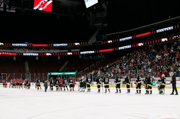 The Metropolitan Riveters and Boston Pride shake hands after the game