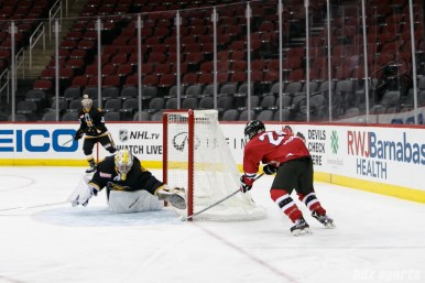 Metropolitan Riveters forward Harrison Browne (24) capitalizes on a missed clear to score the game's first goal