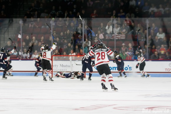 Team Canada defender Micah Zandee-Hart (28) celebrates teammate Natalie Spooner's (24) goal