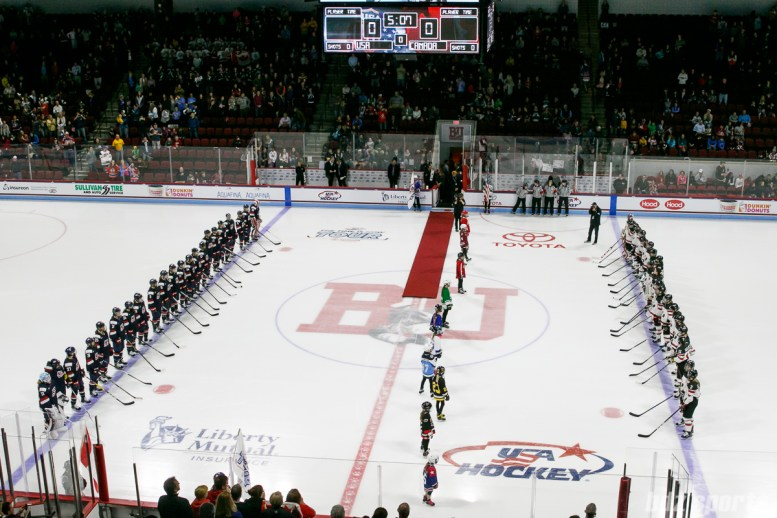 Team USA and Team Canada line up for the playing of the national anthems