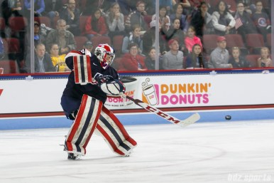 Team USA goalie Nicole Hensley (29) dishes off a pass
