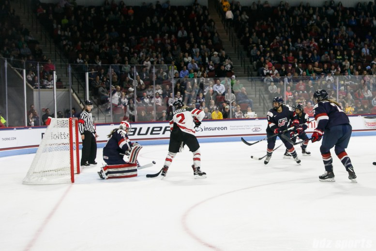 Team USA goalie Nicole Hensley (29) comes up with the save