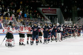 Team USA and Team Canada players shake hands after Canada defeated the host nation 5 - 1 in Boston on October 25, 2017