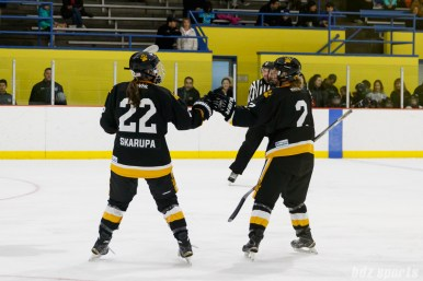 Boston Pride forward Haley Skarupa (22) fist bumps teammate Alyssa Gagliardi (2) after Gagliardi scored the opening goal of the game