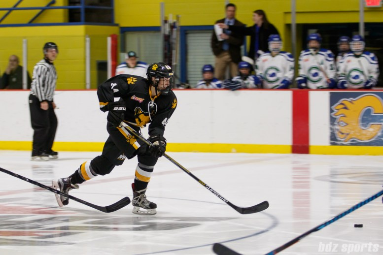 Boston Pride defender Paige Harrington (44) skates after the puck