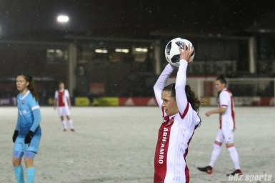 Ajax defender Davina Philtjens (5) takes a throw in