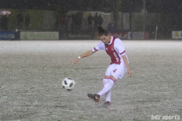 Ajax defender Merel van Dongen (4) sends the ball into the box