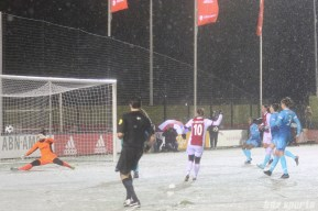 Ajax midfielder Desiree van Lunteren (10) looks on as her shot gets past FC Twente goalie Jade Adan (1)