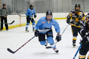 Buffalo Beauts forward Jess Jones (32) chases down the puck