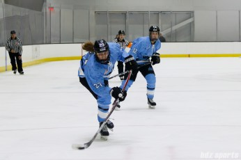Buffalo Beauts forward Corinne Buie (23) releases a shot on goal