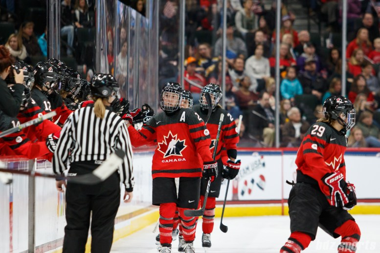 Team Canada high five each other after Marie-Philip Poulin's (29) goal in the second period
