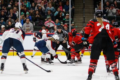 Team USA forward Brianna Decker (14) faces off against Team Canada forward Jennifer Wakefield (9)