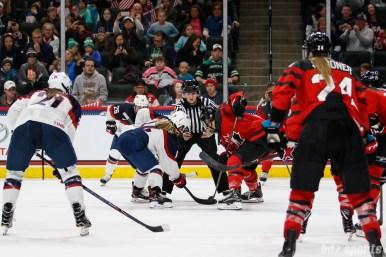 Team USA forward Brianna Decker (14) faces off against Team Canada forward Jennifer Wakefield (9)