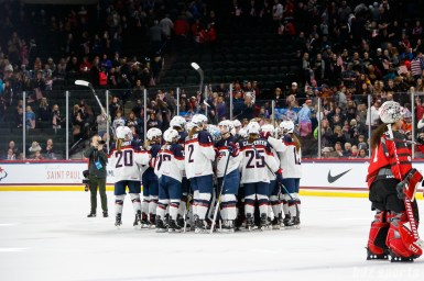 Team USA huddles after 2-1 overtime loss to Team Canada on December 3, 2017