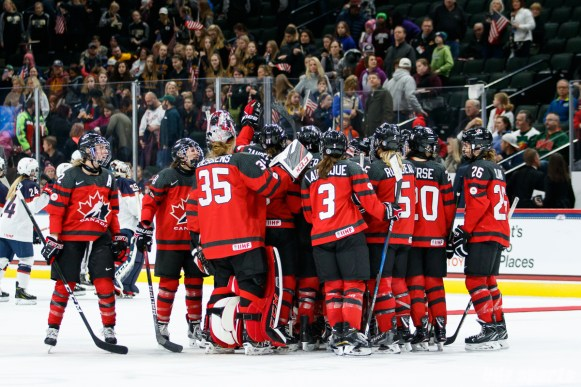 Team Canada huddle after they defeated Team USA 2-1 in overtime at the Xcel Energy Center in St. Paul, MN on December 3, 2017