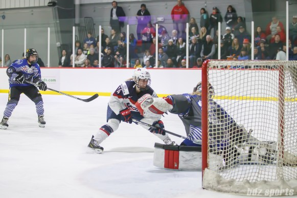 Team NWHL goalie Katie Fitzgerald (35) stops Team USA forward Dani Cameranesi (24) from scoring