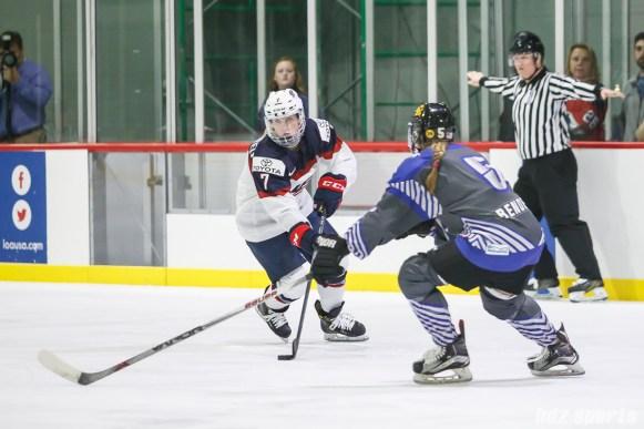Team USA defender Monique Lamoureux-Morando (7) controls the puck for Team USA