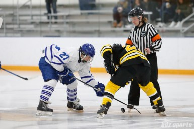 Toronto Furies forward Carolyne Prevost (27) and Boston Blades forward Melissa Bizzari (23) face off to start the game