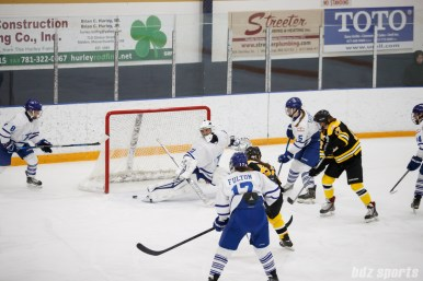 The puck slips past Toronto Furies goalie Sonja van der Bliek (30) for Boston's first goal of the game