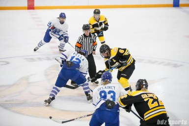 Toronto Furies forward Jess Vella (12) faces off against Boston Blades forward Erin Kickham (6)