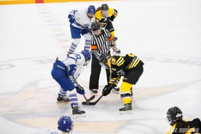 Toronto Furies forward Carolyne Prevost (27) faces off against Boston Blades forward Melissa Bizzari (23)