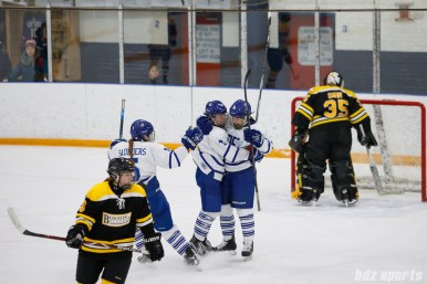 Toronto Furies Michelle Saunders and Hayley Williams hug teammate forward Danielle Gagne (18) after she scored the Furies second goal of the game