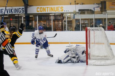 Boston Blades forward Casey Stathopoulos (12) reacts after Toronto Furies goalie Sonja van der Bliek (30) is unable to keep the puck from crossing the goal line